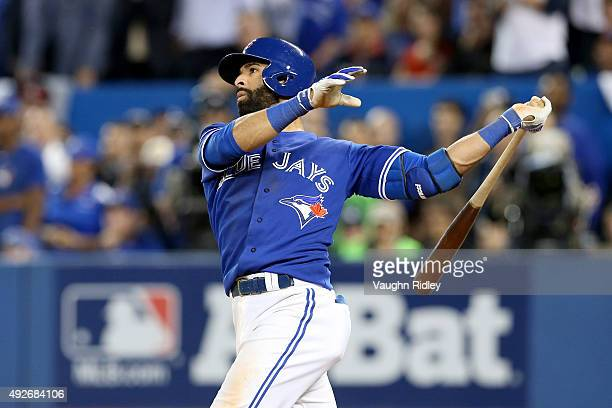 Jose Bautista of the Toronto Blue Jays hits a three-run home run in the seventh inning against the Texas Rangers in game five of the American League...
