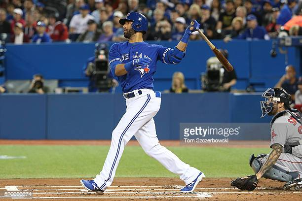 Jose Bautista of the Toronto Blue Jays hits a tworun home run in the first inning during MLB game action against the Boston Red Sox on April 9 2016...