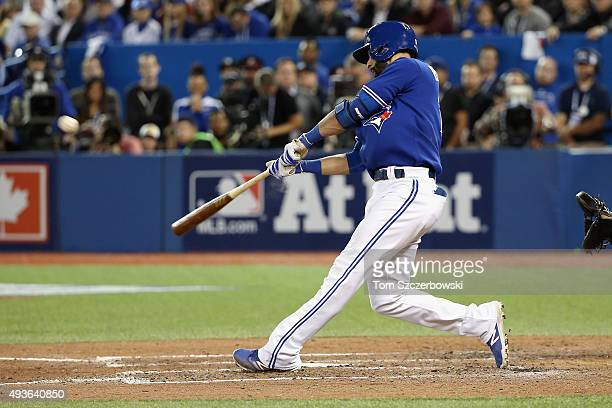 Jose Bautista of the Toronto Blue Jays hits an RBI double in the seventh inning against the Kansas City Royals during game five of the American...