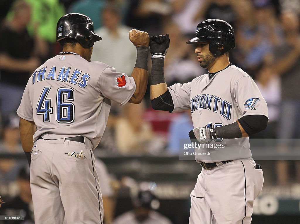 Jose Bautista #19 of the Toronto Blue Jays is congratulated by Eric Thames #46 after hitting a two-run homer in the sixth inning against the Seattle Mariners at Safeco Field on August 16, 2011 in Seattle, Washington.