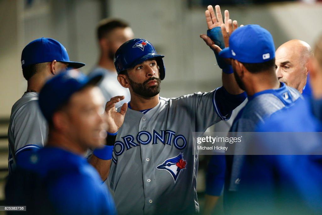 Jose Bautista #19 of the Toronto Blue Jays is congratulated by teammates after scoring against the Chicago White Sox at Guaranteed Rate Field on August 1, 2017 in Chicago, Illinois.
