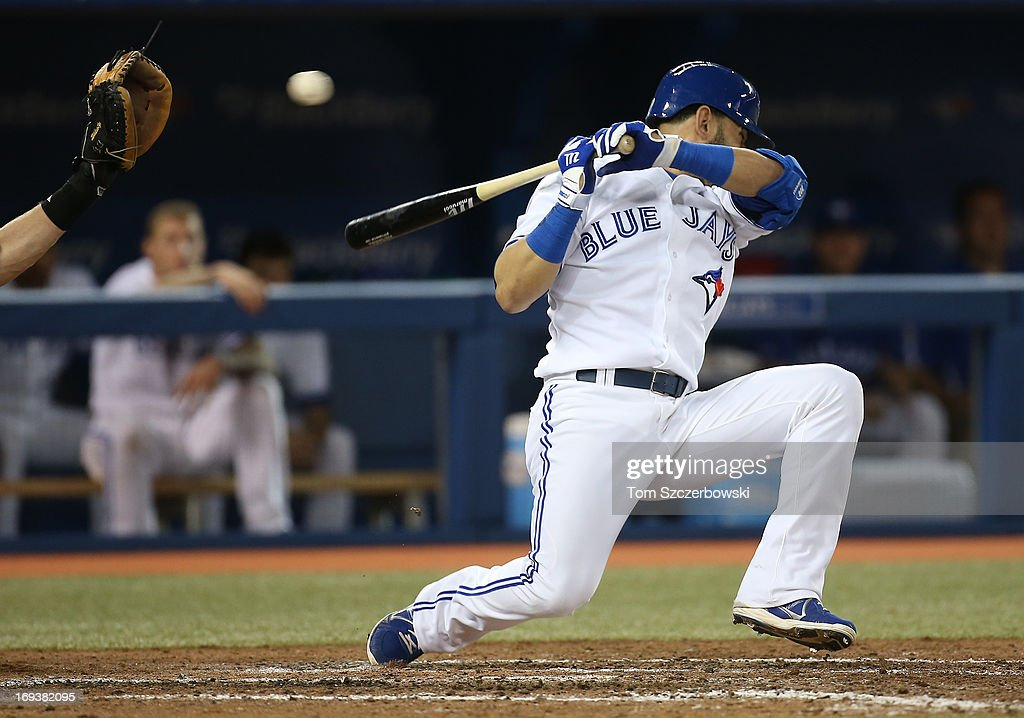 Jose Bautista #19 of the Toronto Blue Jays is knocked down by an inside pitch as he takes ball four and walks on the play in the sixth inning during MLB game action against the Baltimore Orioles on May 23, 2013 at Rogers Centre in Toronto, Ontario, Canada.