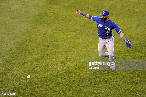 Jose Bautista of the Toronto Blue Jays is unable to catch a ball hit by Ben Zobrist of the Kansas City Royals in the seventh inning in game two of...