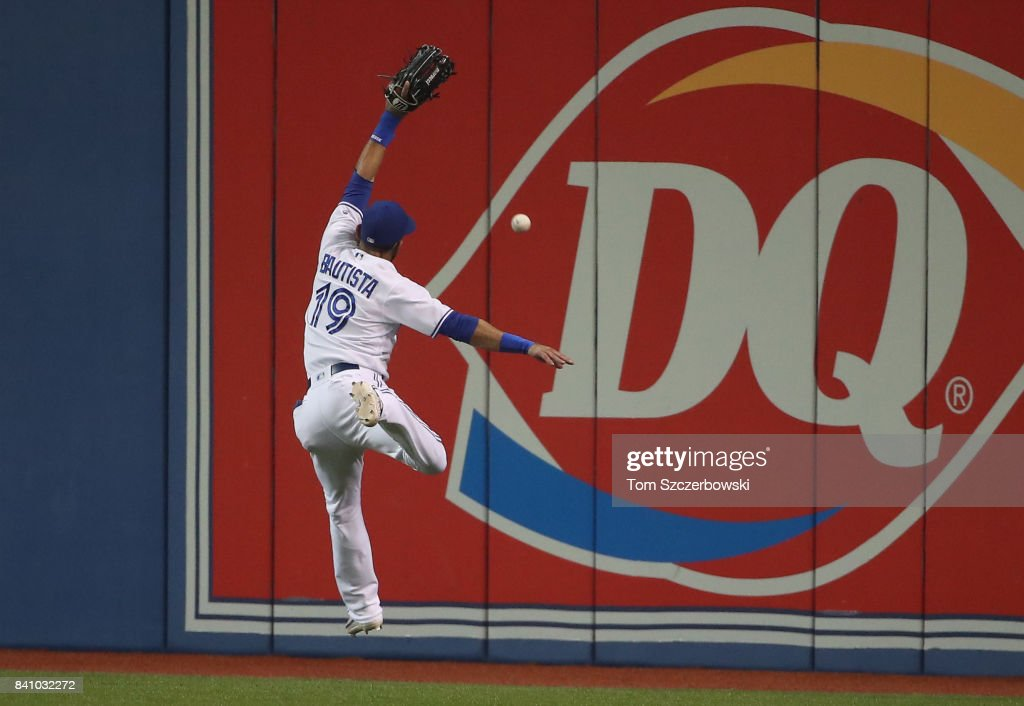 Jose Bautista #19 of the Toronto Blue Jays leaps but cannot get to a ball off the bat of Eduardo Nunez of the Boston Red Sox that went for a double in the first inning during MLB game action at Rogers Centre on August 30, 2017 in Toronto, Canada.