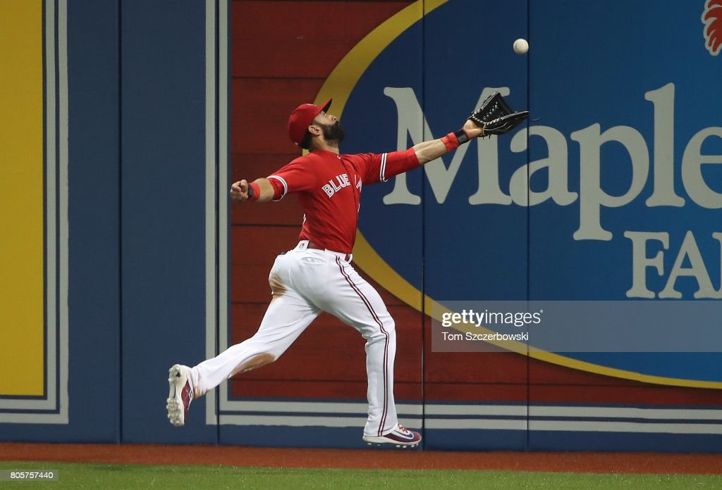 Jose Bautista #31 of the Toronto Blue Jays leaps but cannot get to a two-run double hit by Deven Marrero #17 of the Boston Red Sox in the seventh inning during MLB game action at Rogers Centre on July 2, 2017 in Toronto, Canada.