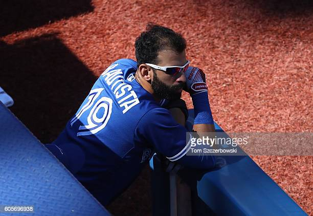 Jose Bautista of the Toronto Blue Jays looks on from the top step of the dugout during MLB game action against the Tampa Bay Rays on September 14...