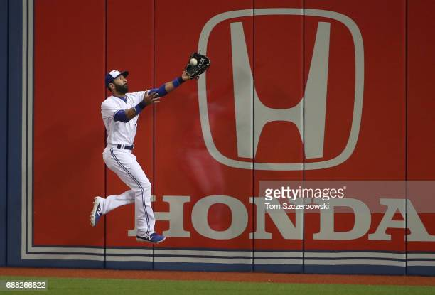 Jose Bautista of the Toronto Blue Jays makes a catch against the wall to end the fifth inning during MLB game action against the Baltimore Orioles at...