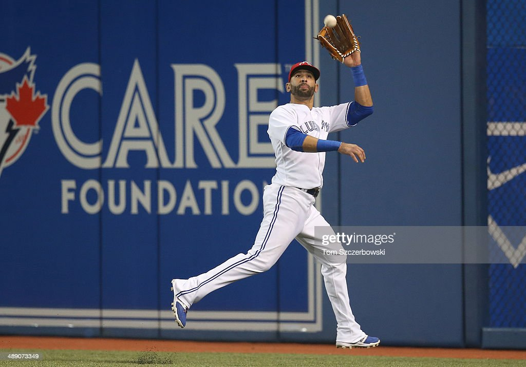 Jose Bautista #19 of the Toronto Blue Jays makes a runnig catch in the sixth inning during MLB game action against the Los Angeles Angels of Anaheim on May 9, 2014 at Rogers Centre in Toronto, Ontario, Canada.