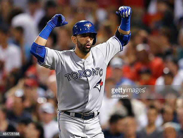 Jose Bautista of the Toronto Blue Jays reacts after he hit a tworun home run against the Boston Red Sox in the sixth inning at Fenway Park on...