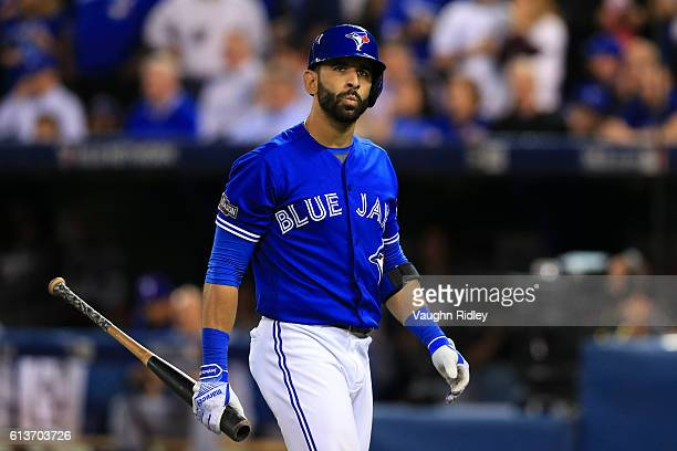 Jose Bautista of the Toronto Blue Jays reacts after striking out for the first out of the tenth inning against the Texas Rangers during game three of...