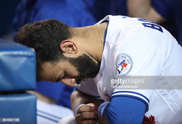 Jose Bautista of the Toronto Blue Jays reacts as he sits in the dugout during MLB game action against the Tampa Bay Rays on September 13 2016 at...