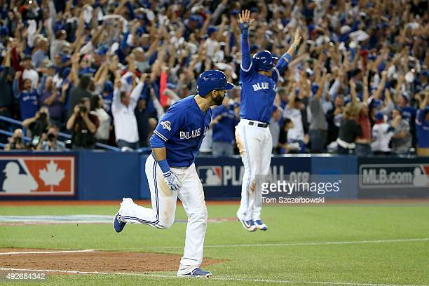 Jose Bautista of the Toronto Blue Jays rounds the bases after he hits a three-run home run in the seventh inning against the Texas Rangers in game...