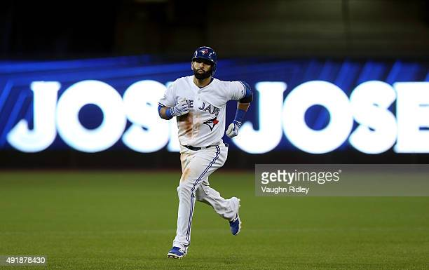 Jose Bautista of the Toronto Blue Jays rounds the bases after hitting a solo home run against Keone Kela of the Texas Rangers in the sixth inning...
