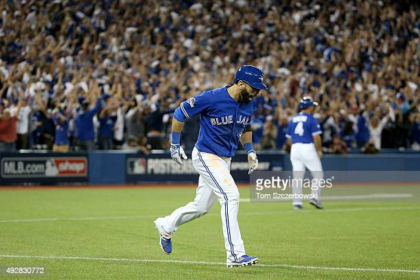 Jose Bautista of the Toronto Blue Jays rounds the bases as he hits a threerun home run in the seventh inning off Sam Dyson of the Texas Rangers in...