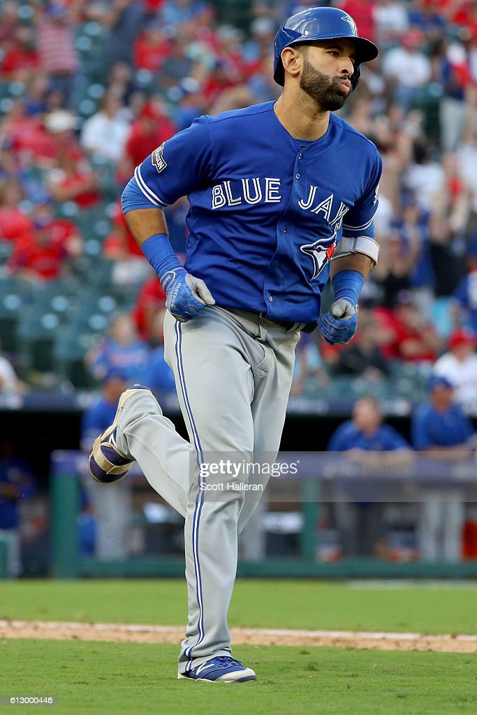 Jose Bautista #19 of the Toronto Blue Jays runs after hitting a three run home run to left field against Jake Diekman #41 of the Texas Rangers during the ninth inning in game one of the American League Divison Series at Globe Life Park in Arlington on October 6, 2016 in Arlington, Texas.