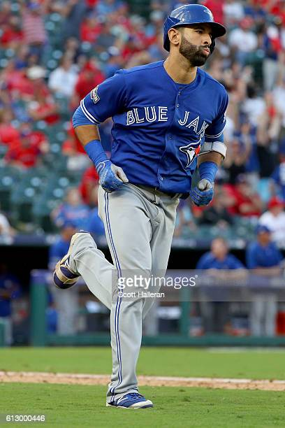 Jose Bautista of the Toronto Blue Jays runs after hitting a three run home run to left field against Jake Diekman of the Texas Rangers during the...