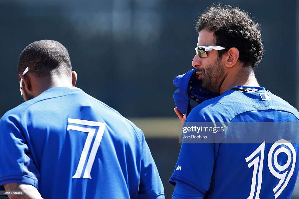 Jose Bautista #19 of the Toronto Blue Jays shares a word with Jose Reyes #7 before the game against the Pittsburgh Pirates at Florida Auto Exchange Stadium on March 3, 2015 in Dunedin, Florida.