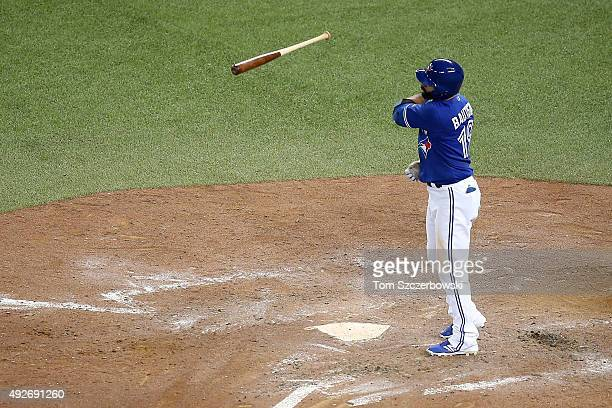 Jose Bautista of the Toronto Blue Jays throws his bat up in the air after he hits a threerun home run in the seventh inning against the Texas Rangers...
