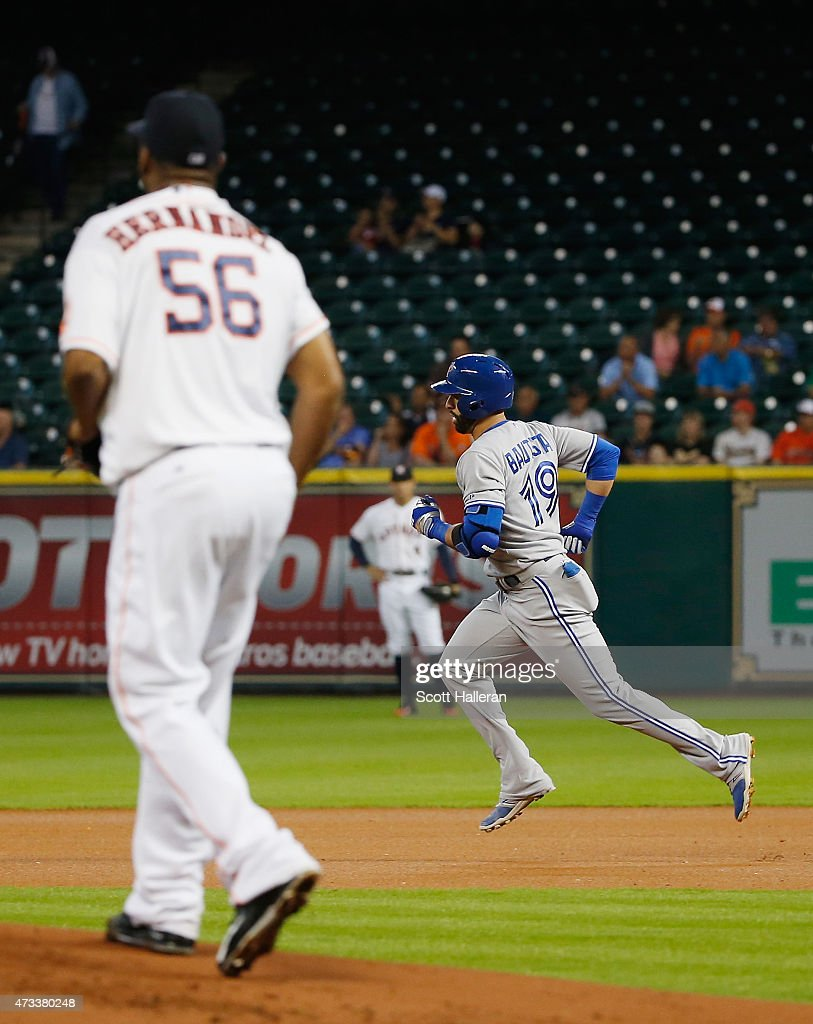 Jose Bautista #19 of the Toronto Blue Jays trots around the bases after hitting a solo home run off Roberto Hernandez #56 of the Houston Astros in the first inning of their game at Minute Maid Park on May 14, 2015 in Houston, Texas.