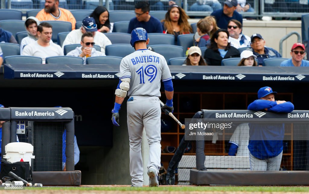 Jose Bautista #19 of the Toronto Blue Jays walks back to the dugout after striking out in the seventh inning against the New York Yankees at Yankee Stadium on September 30, 2017 in the Bronx borough of New York City.