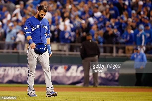 Jose Bautista of the Toronto Blue Jays walks off the field after being forced out at second base in the eighth inning against the Kansas City Royals...