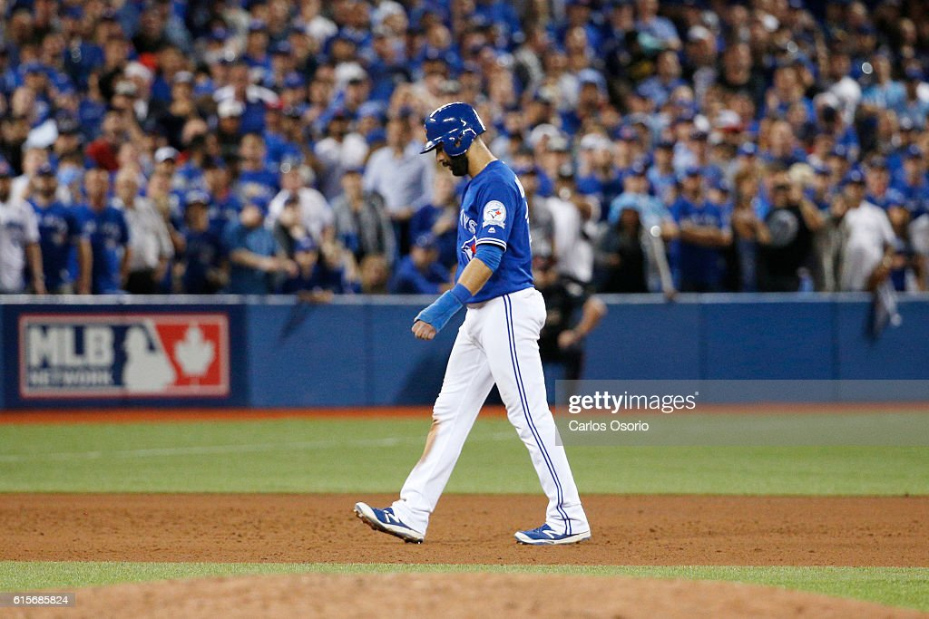 TORONTO, ON - OCTOBER, 19 - Jose Bautista #19 of the Toronto Blue Jays walks off the field after the Jays loss to the Cleveland Indians in Game 5 of the ALCS baseball series at the Rogers Centre in Toronto, October 19, 2016. The Indians advance to the World Series.