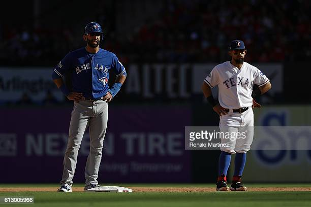 Jose Bautista of the Toronto Blue Jays walks to second base past Rougned Odor of the Texas Rangers in game one of the American League Division Series...
