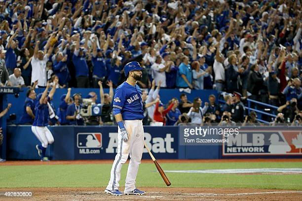 Jose Bautista of the Toronto Blue Jays watches after he he hits a threerun home run in the seventh inning against the Texas Rangers in game five of...