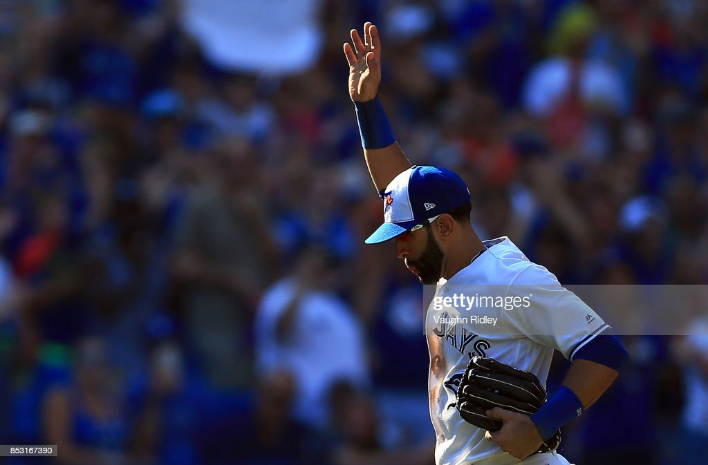 Jose Bautista #19 of the Toronto Blue Jays waves to the fans after he is pulled from the game in the ninth inning during MLB game action against the New York Yankees at Rogers Centre on September 24, 2017 in Toronto, Canada.