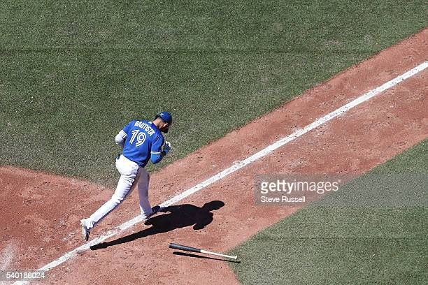 TORONTO ON JUNE 14 Jose Bautista runs after flying out as the Toronto Blue Jays play an afternoon game against the Philadelphia Phillies in Toronto...