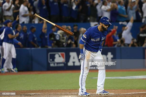 Jose Bautista tosses his bat after hitting a three run home The Toronto Blue Jays and Texas Rangers play game four of the MLB American League...