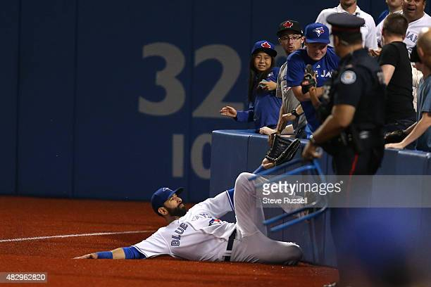 TORONTO ON AUGUST 4 Jose Bautista tries to track down a ball in foul territory as the Toronto Blue Jays play the Minnesota Twins in Toronto August 4...