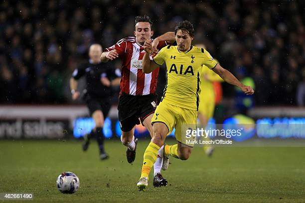 Jose Baxter of Sheff Utd battles with Benjamin Stambouli of Spurs during the Capital One Cup SemiFinal Second Leg match between Sheffield United and...