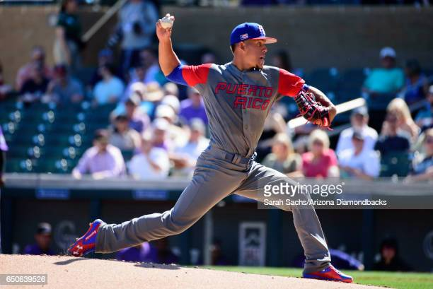 Jose Berrios of Puerto Rico delivers a pitch during an exhibition game against the Colorado Rockies on March 9 2017 in Scottsdale Arizona
