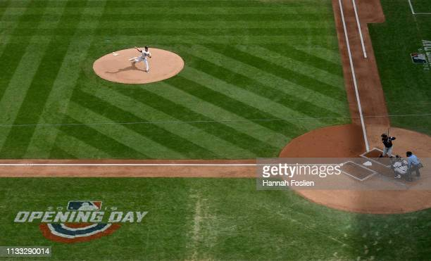 Jose Berrios of the Minnesota Twins delivers the first pitch of the Opening Day game to Leonys Martin of the Cleveland Indians as Jason Castro of the...
