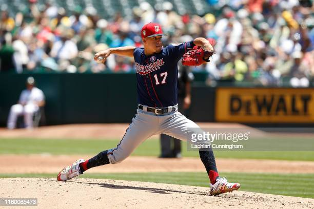Jose Berrios of the Minnesota Twins pitches in the bottom of the second inning against the Oakland Athletics at Ring Central Coliseum on July 04 2019...