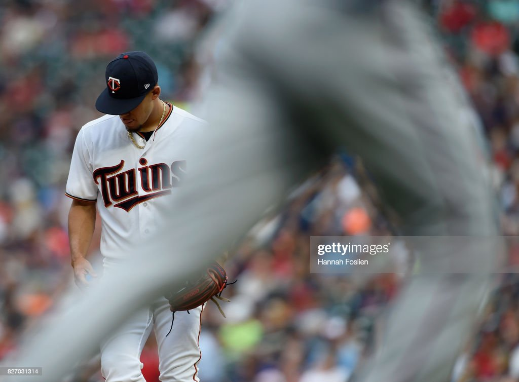 Jose Berrios #17 of the Minnesota Twins reacts as Nomar Mazara #30 of the Texas Rangers rounds the bases after a three-run home run by teammate Adrian Beltre #29 during the first inning of the game on August 6, 2017 at Target Field in Minneapolis, Minnesota.