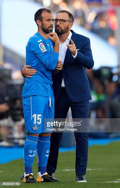 Jose Bordalas manager of Getafe gives instructions to Francisco Molinero of Getafe during the La Liga match between Getafe and Villarreal at Coliseum...