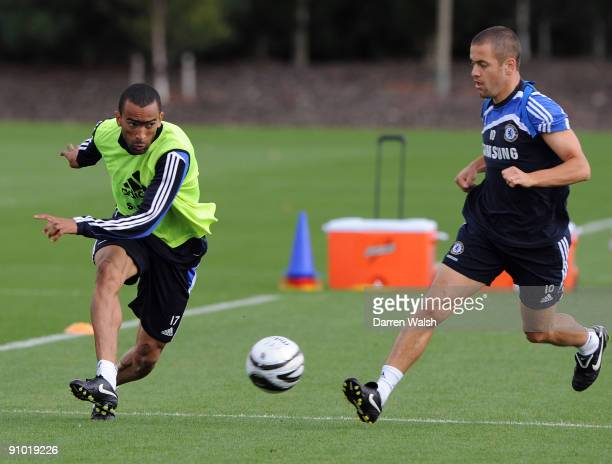 Jose Bosingwa and Joe Cole of Chelsea in action during a training session at the Cobham training ground on September 22, 2009 in Cobham, Surrey.