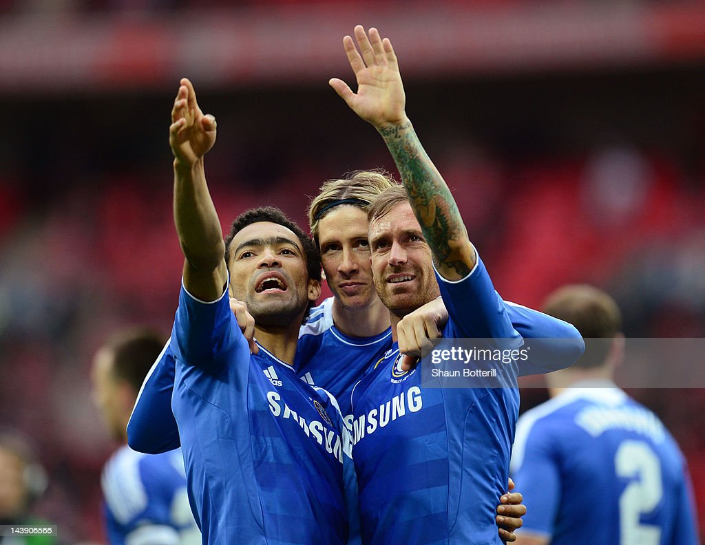 Jose Bosingwa, Fernando Torres and Raul Meireles of Chelsea celebrate victory during the FA Cup with Budweiser Final match between Liverpool and Chelsea at Wembley Stadium on May 5, 2012 in London, England.