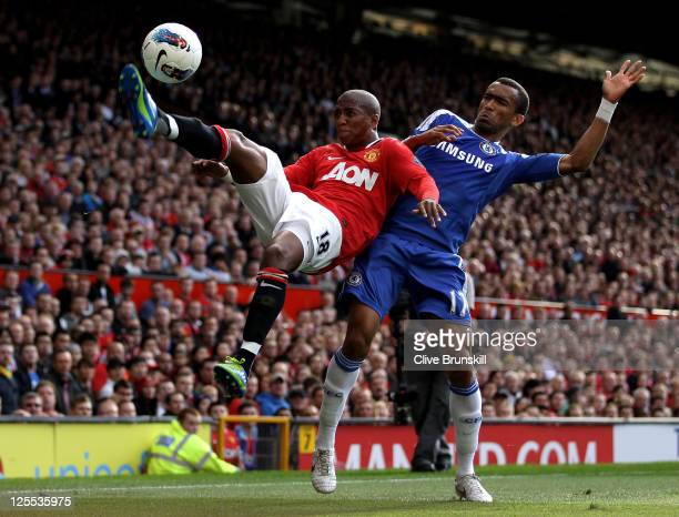 Jose Bosingwa of Chelsea competes with Ashley Young of Manchester United during the Barclays Premier League match between Manchester United and...