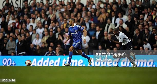 Jose Bosingwa of Chelsea gets past Darren Bent of Tottenham during the Barclays Premier League match between Tottenham Hotspur and Chelsea at White...