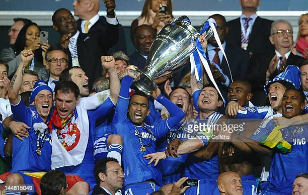 Jose Bosingwa of Chelsea lifts the trophy in celebration after their victory in the UEFA Champions League Final between FC Bayern Muenchen and...