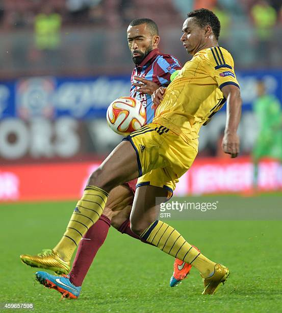 Jose Bosingwa of Trabzonspor vies with Jaja of Metalisst Kharkiv during the UEFA Europa League Group L football match at Huseyin Avni Aker Stadium in...