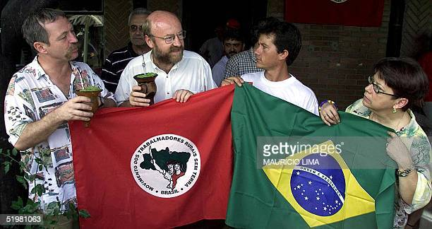 Jose Bove , French farmer leader and antiglobalization activist, drinks mate with unidentified members of the Country Workers Without Land Movement...