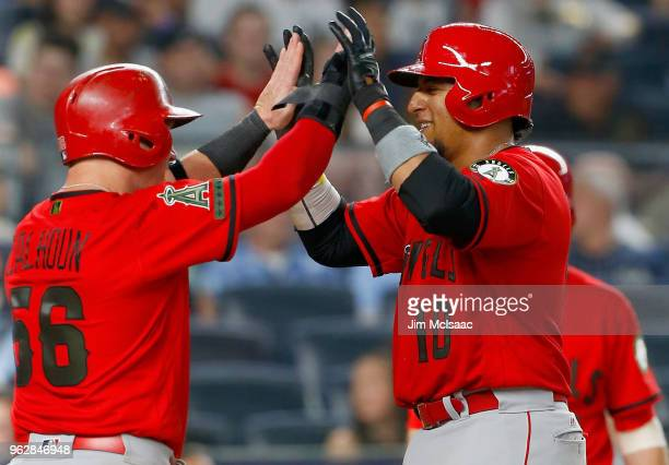 Jose Briceno of the Los Angeles Angels of Anaheim celebrates his seventh inning two run home run against the New York Yankees with teammate Kole...