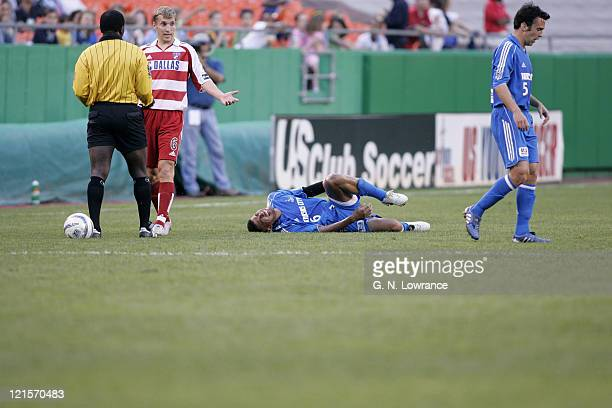Jose Burciaga Jr of the Kansas City Wizards withers in pain against FC Dallas during an MLS game on May 7 2005 at Arrowhead Stadium in Kansas City Mo...