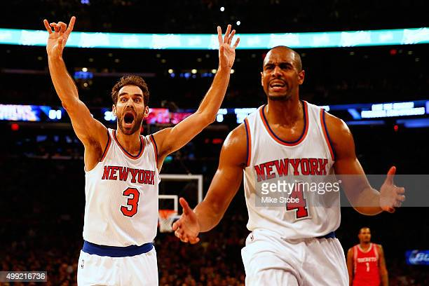 Jose Calderon and Arron Afflalo of the New York Knicks reacts during the game against the Houston Rockets at Madison Square Garden on November 29...