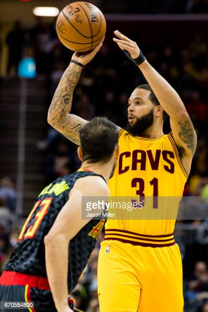 Jose Calderon of the Atlanta Hawks guards Deron Williams of the Cleveland Cavaliers during the first half at Quicken Loans Arena on April 7 2017 in...