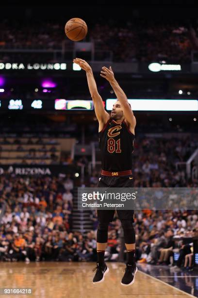 Jose Calderon of the Cleveland Cavaliers attempts a three point shot against the Phoenix Suns during the first half of the NBA game at Talking Stick...